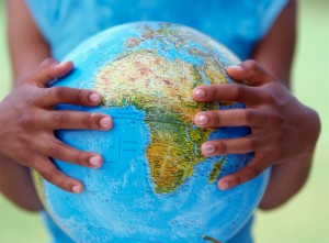 Girl's hands holding globe